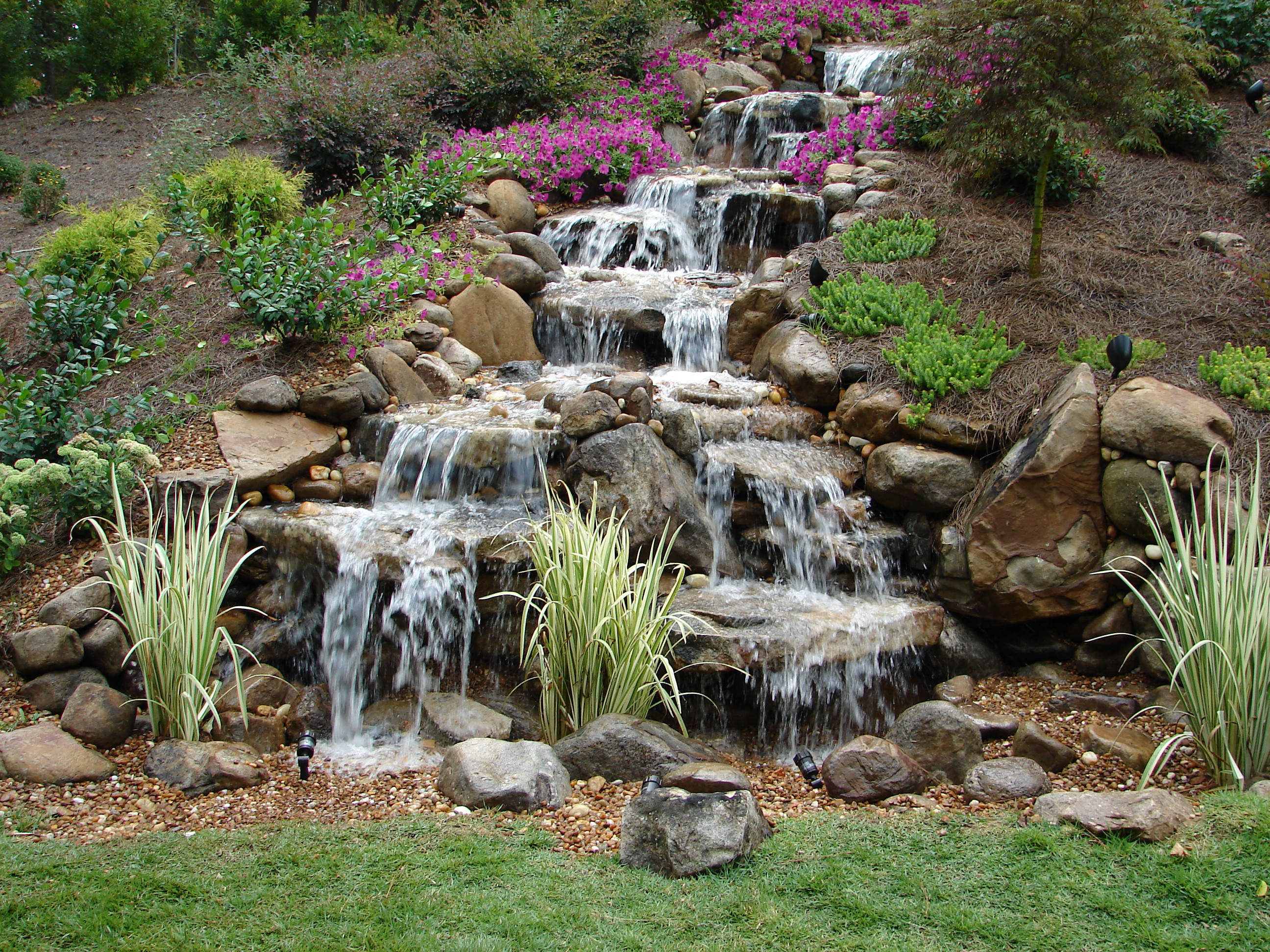 Pondless waterfalls a unique element to any backyard get for Waterfall fountain
